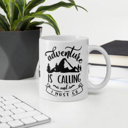 Adventure is Calling 11oz coffee and tea mug on desk